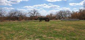 John Deere tractor in an open field.